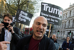 London, April 7th 2017. Anti war protesters demonstrate in London outside Downing Street following the US missile strikes against a Syrian air base in the wake of a suspected chemical attack. PICTURED: A man claiming to be a Syrian refugee disrupts the protesters' chants against Theresa May's support for Trump's missile attacks. Credit: Paul Davey