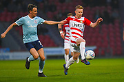Ali Crawford of Doncaster Rovers (11) and Sean McConville of Accrington Stanley (11) in action during the EFL Sky Bet League 1 match between Doncaster Rovers and Accrington Stanley at the Keepmoat Stadium, Doncaster, England on 23 April 2019.