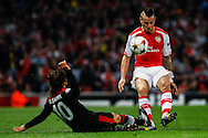 Mathieu Debuchy of Arsenal is tackled by Olcay Sahan of Besiktas J.K. during the UEFA Champions League match at the Emirates Stadium, London<br /> Picture by David Horn/Focus Images Ltd +44 7545 970036<br /> 27/08/2014