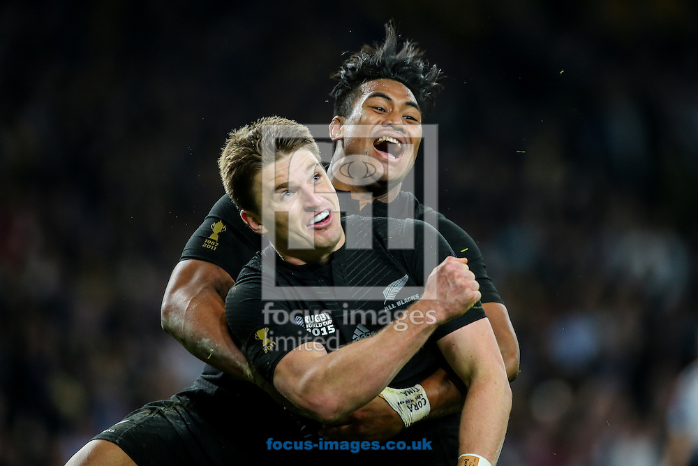 Beauden Barrett of New Zealand (front) is congratulated by Julian Savea of New Zealand (back) after scoring a try during the final of the 2015 Rugby World Cup at Twickenham Stadium, Twickenham<br /> Picture by Andy Kearns/Focus Images Ltd 0781 864 4264<br /> 31/10/2015