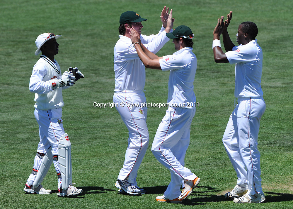 Shingirai Masakadza (R) celebrates with team mates on day 1 of the first cricket test, New Zealand v Zimbabwe at McLean Park. Thursday 26 January 2012. Napier, New Zealand. Photo: Andrew Cornaga/Photosport.co.nz