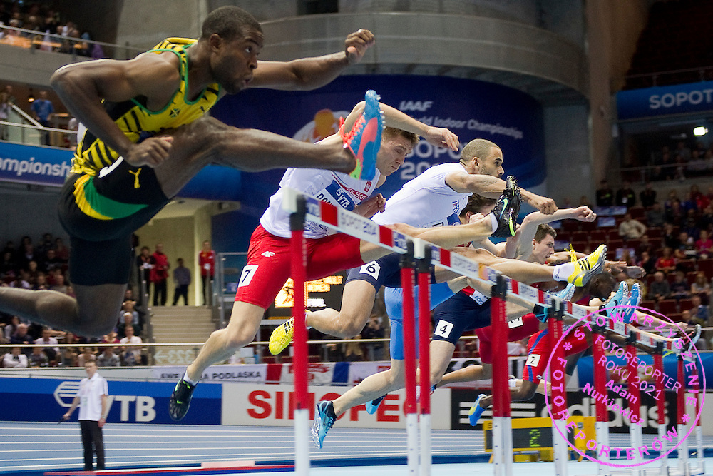 (2L) Dominik Bochenek of Poland competes in men's 60 meters hurdles Semi-Final during the IAAF Athletics World Indoor Championships 2014 at Ergo Arena Hall in Sopot, Poland.<br /> <br /> Poland, Sopot, March 9, 2014.<br /> <br /> Picture also available in RAW (NEF) or TIFF format on special request.<br /> <br /> For editorial use only. Any commercial or promotional use requires permission.<br /> <br /> Mandatory credit:<br /> Photo by &copy; Adam Nurkiewicz / Mediasport