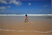 South Africa, Eastern Cape, Kaysers Beach. Toddler running sea.<br /> <br /> Photo: &copy; Zute Lightfoot