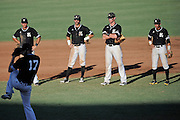 May 26, 2012: Kennesaw Owls infielder watch as relief Kennesaw Owls pitcher Josh Carr (17) warms up during ASUN Championship baseball game action between the Kennesaw Owls and the Belmont Bruins. Belmont defeated Kennesaw 10-4 to win their second straight ASUN Championship at Melching Field at Conrad Park in De Land, FL