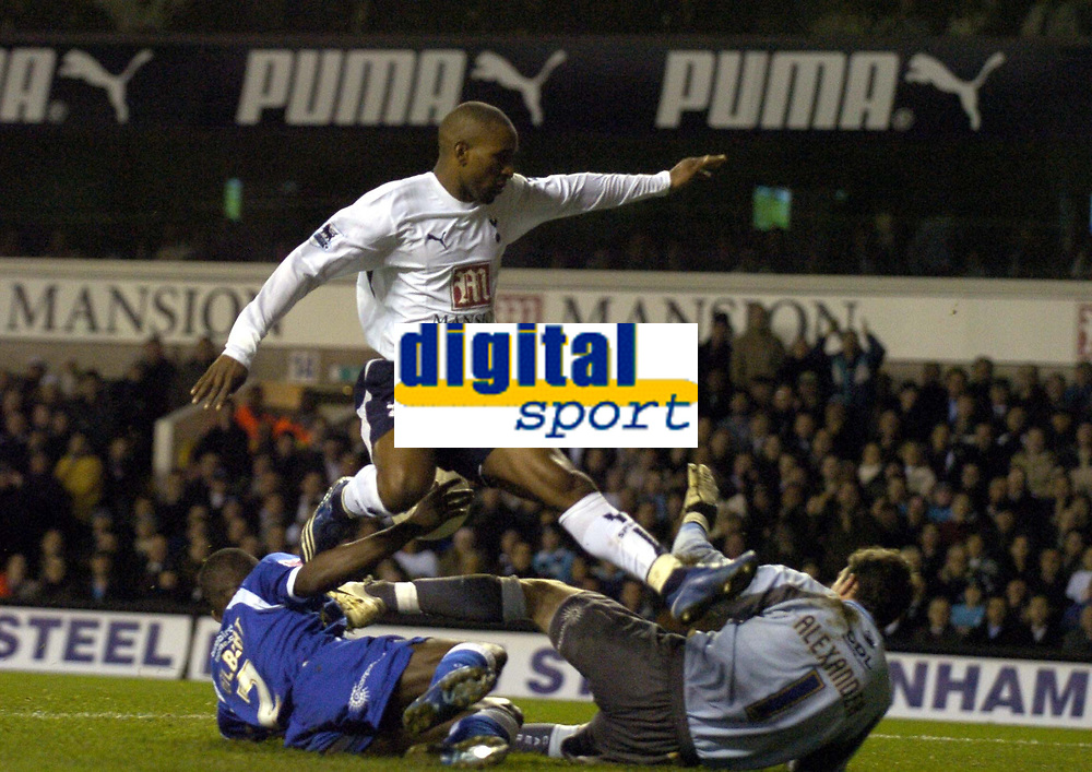 Photo: Olly Greenwood.<br />Tottenham Hotspur v Cardiff City. The FA Cup. 17/01/2007. Tottenham's Jermaine Defoe scores despite  Cardiff's Neil Alexander coming out to save