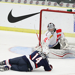 COBOURG, - Dec 16, 2015 -  Game #7 - United States vs Switzerland at the 2015 World Junior A Challenge at the Cobourg Community Centre, ON. Josh Wilkins #14 of Team United States shoots the puck from a prone position during the first period. (Photo: Tim Bates / OJHL Images)