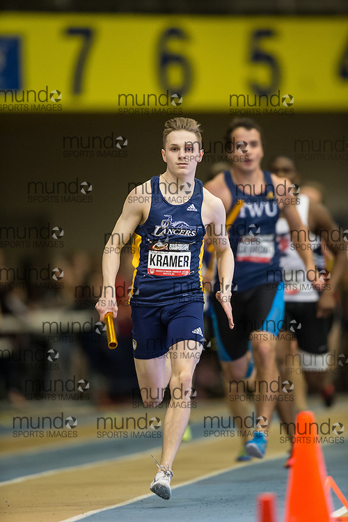 Windsor, Ontario ---2015-03-14--- Chris Kramer of University of Windsor  competes in the 4x400m relay at the 2015 CIS Track and Field Championships in Windsor, Ontario, March 14, 2015.<br /> GEOFF ROBINS/ Mundo Sport Images