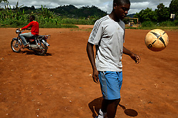 Christian Nankap, 17 trains on Madela training ground in Cite Verte. Yaounde, Cameroon. Christian Nankap, 17 years old is a young talented player in Yaounde. He is about to go to Florida, USA to train on FC Orlando's training program. If he is as good as they hope the club plans to sell him to a European club when he turns 18. Christian's family lost a lot of money when a rogue agent offered to bring Christian's older brother to Europe and then disappeared with the money. A lot of expectations hangs on Christian's shoulders. ..