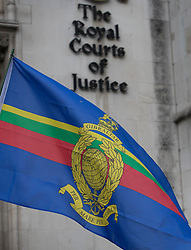 © Licensed to London News Pictures. 16/12/2016. London, UK. A Royal Marines flag flies at the High Court as Claire Blackman, wife of Sgt Alexander Blackman, arrives to attend a bail hearing. Sgt Alexander Blackman is currently serving a life sentence after being convicted of murdering a wounded Taliban fighter in Afghanistan in 2011. Photo credit: Peter Macdiarmid/LNP