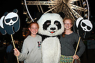 Kids enjoy meeting the WWF Panda during the WWF - Earth Hour Event held at the amphitheatre at the Victoria and Alfred Waterfront in Cape Town, South Africa on the 29th March 2014<br /> <br /> <br /> Photo by: RON GAUNT