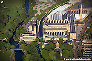 aerial photograph of Salt's Mill Saltaire, Bradford, West Yorkshire, England. When built in 1853  by Sir Titus Salt, the mill was  the largest industrial building in the world. Today it houses and art gallery and mixed commercial and residential use.