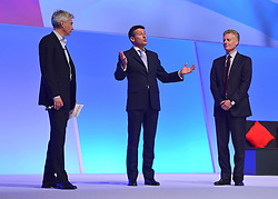 © Licensed to London News Pictures. 02/10/2012. Manchester, UK Jonathan Edwards, Lord Sebastian Coe and Paul Deighton LOCOG CEO. The Labour Party Conference Day 3 at Manchester Central. Photo credit : Stephen Simpson/LNP