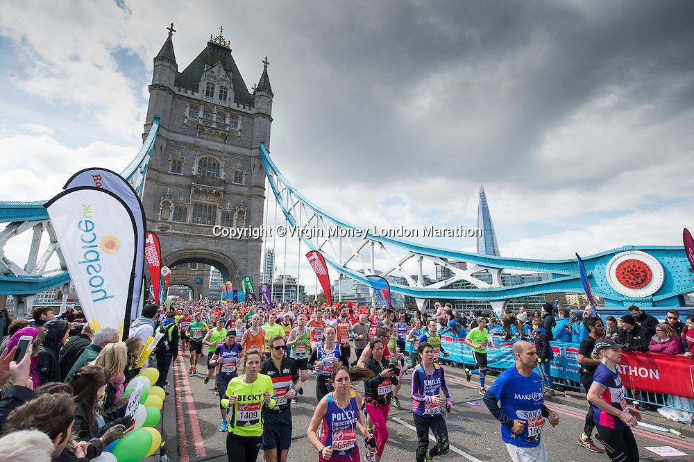 The mass of runners crossing Tower Bridge. The Virgin Money London Marathon, Sunday 24th April 2016.<br /> <br /> Photo: Thomas Lovelock for Virgin Money London Marathon<br /> <br /> For more information please contact media@londonmarathonevents.co.uk