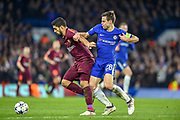 Barcelona forward Luis Suarez (9) under pressure from Chelsea defender Cesar Azpilicueta (28) during the Champions League match between Chelsea and Barcelona at Stamford Bridge, London, England on 20 February 2018. Picture by Martin Cole.