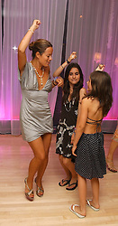 JADE JAGGER and her daughters left. to right, Assisi and Amber dancing at party in aid of cancer charity Clic Sargent held at the Sanderson Hotel, Berners Street, London on 4th July 2005.<br />