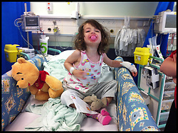 Yasmin Parsons comes round in the recovery unit at  Great Ormond street hospital after being diagnosed with Leukaemia, August, 2012, Photo By Andrew Parsons / i-Images