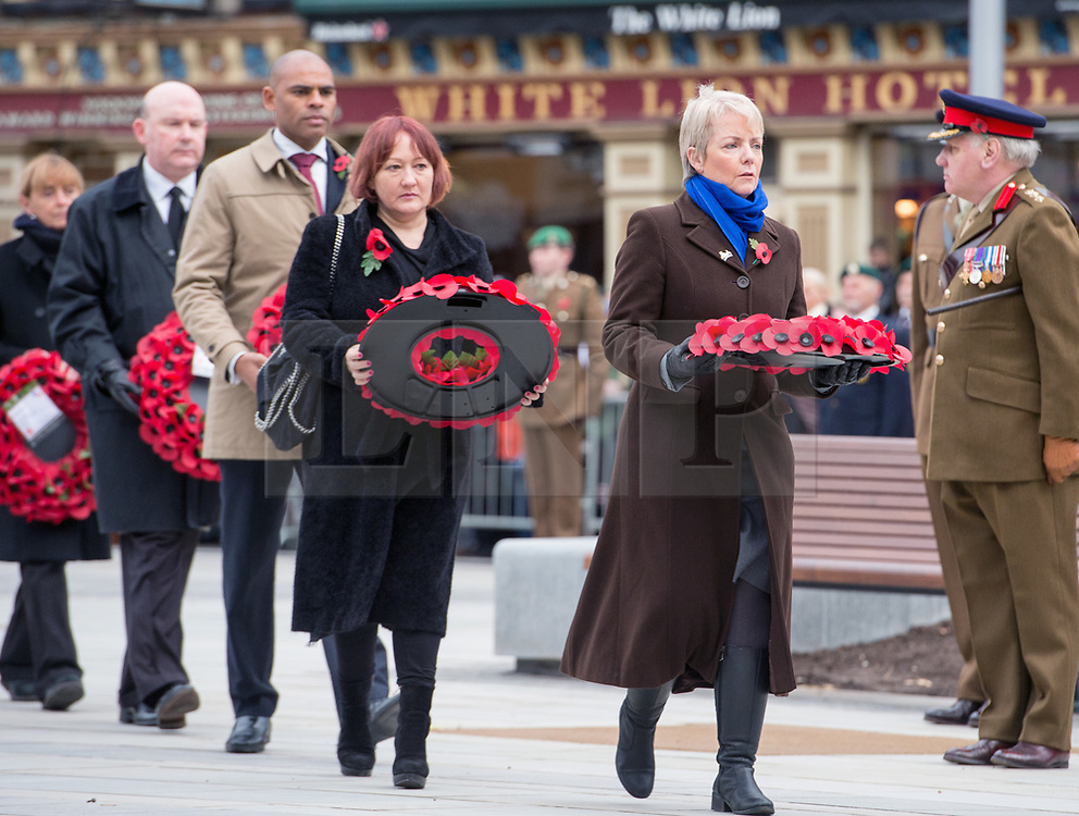 © Licensed to London News Pictures.  12/11/2017; Bristol, UK. Remembrance Sunday at the Cenotaph in Bristol. KERRY MCCARTHY MP (red hair) takes a wreath to the Cenotaph. Picture credit : Simon Chapman/LNP