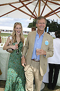 Poppy Delevigne and her father Charles Delevigne, Cartier International Polo. Guards Polo Club. Windsor Great Park. 30 July 2006. ONE TIME USE ONLY - DO NOT ARCHIVE  © Copyright Photograph by Dafydd Jones 66 Stockwell Park Rd. London SW9 0DA Tel 020 7733 0108 www.dafjones.com
