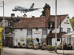 **2018 Pictures of the year by London News Pictures**<br /> © Licensed to London News Pictures. 05/06/2018. London, UK. A Singapore Airlines A380 passenger jet comes into land at Heathrow airport in sight of The White Horse pub in the village of Longford. The small village to the north of the current airport would be demolished to make way for a third runway under plans given the go-ahead today by the government. Photo credit: Peter Macdiarmid/LNP