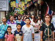 03 SEPTEMBER 2016 - BANGKOK, THAILAND: Pom Mahakan residents block an alley in their community to prevent Bangkok officials from demolishing their homes. Hundreds of people from the Pom Mahakan community and other communities in Bangkok barricaded themselves in the Pom Mahakan Fort to prevent Bangkok officials from tearing down the homes in the community Saturday. The city had issued eviction notices and said they would reclaim the land in the historic fort from the community. People prevented the city workers from getting into the fort. After negotiations with community leaders, Bangkok officials were allowed to tear down 12 homes that had either been abandoned or whose owners had agreed to move. The remaining 44 families who live in the fort have vowed to stay.      PHOTO BY JACK KURTZ