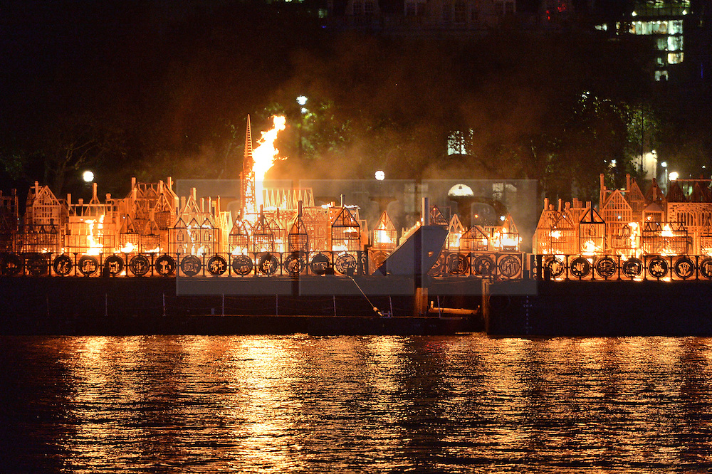 © Licensed to London News Pictures. 04/09/2016. London, UK. London 1666, a 120-metre long sculpture of the 17th-century London skyline was set alight in a dramatic retelling of the story of the Great Fire of London on Sunday evening. A collaboration between American 'burn' artist David Best and Artichoke, the project has involved months of work and participation with local schools and young Londoners. The event was part of the London's Burning festival produced by Artichoke, commemorating the Great Fire of London.  Photo credit: Ray Tang/LNP
