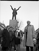 Workers Party Commemoration Of James Larkin.(R50)..1987..07.02.1987..02.07.1987..7th February 1987..A wreath laying ceremony was held today at the memorial for Trade Union leader,James Larkin. The ceremony was conducted the Workers' Party. Mr Tomás McGiolla, leader of the Workers'Party, laid the wreath at the memorial in O'Connell Street, Dublin. The ceremony was held to commomerate the 40th anniversary of the death of James Larkin...Image shows Mr McGiolla holding wreath at the monument in O'Connell Street. Include in the photograph are Clrs, E Byrne, Eamon Gilmore, Mike Jennings and Pat Rabbitte.