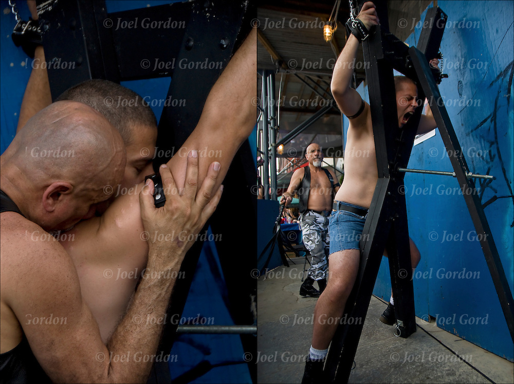 Bondage slave being whipped and flogged by master at S&amp;M Bondage  adult-themed Street fair, Folsom Street East in New York City. <br />