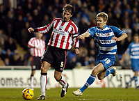 Photo: Leigh Quinnell.<br /> Reading v Southampton. Coca Cola Championship. 10/02/2006. Reading Kevin Doyle gets hold of Southampton captain Claus Lundekvam.
