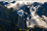 Whirl clouds inside the mountain ravine