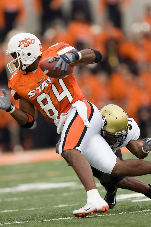 Oklahoma State Cowboys wide receiver D'Juan Woods tries to avoid a tackle during a 34 to 0 loss to the Colorado Buffaloes on October 1, 2005 at Boone Pickens Stadium in Stillwater, Oklahoma.