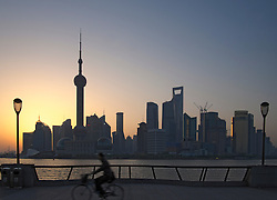 View of skyline of Pudong from The Bund at dawn in Shanghai China