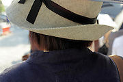 woman wearing a fashionable hat to protect herself against the strong sun