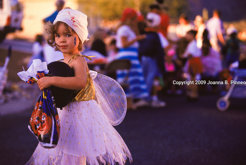 A little girl is dressed-up in costume for a Halloween party in the suburbs of Tucson, AZ. Aurora image #1960112102