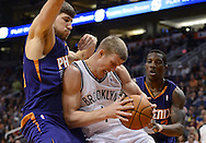 Nov 15, 2013; Phoenix, AZ, USA; Brooklyn Nets forward Mason Plumlee (1) handles the ball against the Phoenix Suns center Viacheslav Kravtsov (55) and guard Eric Bledsoe (2) in the first half at US Airways Center. The Nets defeated the Suns 100-98 in overtime. Mandatory Credit: Jennifer Stewart-USA TODAY Sports