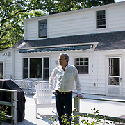 Port Chester, NY : Kevin Barrett, a lawyer working for the Attorney General of West Virginia, poses for a portrait on the back porch of his Port Chester, New York home on Wednesday morning. Barrett and the West Virginia AG are working on the bankruptcy of Alpha Natural Resources, which bought the coal company Massey Energy. CREDIT: Karsten Moran for The New York Times