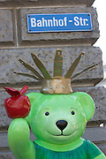 Teddy-Summer2005 in Zurich, Switzerland. .Crown bear with apple, Bahnhofstrasse..After the success of the summer events in recent years - the cows in 1998 and benches in 2001, the city of Zurich is continuing the tradition this year with «Teddy Summer 2005». From May 23rd until September 18th around 630 teddies - small, large, in groups, sitting or standing and creatively decorated by various artists will make their mark on the city of Zurich and the airport Zurich-Kloten. With the choice of the teddy bear as subject for this years project, they have found a symbol recognized and loved by young and old. Although he's over 100 years old, Teddy moves with the times and his cuddly figure continues to capture the hearts of people the world over.