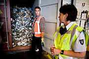 Safety Advisor Harriëtte Smidt from Dutch Customs and Arno Vink of VROM are checking container shipments on illegal waste at the customs office in the harbor of Rotterdam, Netherlands Incoming containers are being scanned and checked on illegal waste that is passing through the harbor on it's way other countries in the world on 28 May, 2009. (Photo by Michel de Groot)