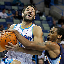 January 18, 2012; New Orleans, LA, USA; New Orleans Hornets point guard Greivis Vasquez (21) is defended by Memphis Grizzlies point guard Mike Conley (11) during the first quarter of a game at the New Orleans Arena.   Mandatory Credit: Derick E. Hingle-USA TODAY SPORTS