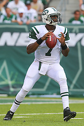 EAST RUTHERFORD, NJ - SEPTEMBER 7: Geno Smith (7) of the New York Jets drops back to pass during the first quarter of their game against the Oakland Raiders at MetLife Stadium on September 7, 2012 in East Rutherford, NJ.  (Photo by Ed Mulholland/Getty Images) *** Local Caption *** Geno Smith