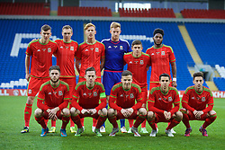 CARDIFF, WALES - Tuesday, March 31, 2015: Wales' players line up for a team group photograph before the 2017 UEFA European Under-21 Championship Qualifying Group 5 match against Bulgaria at the Cardiff City Stadium. Back row L-R: Joseph Wright, Ryan Hedges, Joshua Yorwerth, goalkeeper Christian Dibble, Declan John, Ellis Harrison. Front row L-R: Wesley Burns, captain Gethin Jones, Lee Evans, Thomas O'Sullivan, Joshua Sheehan. (Pic by David Rawcliffe/Propaganda)