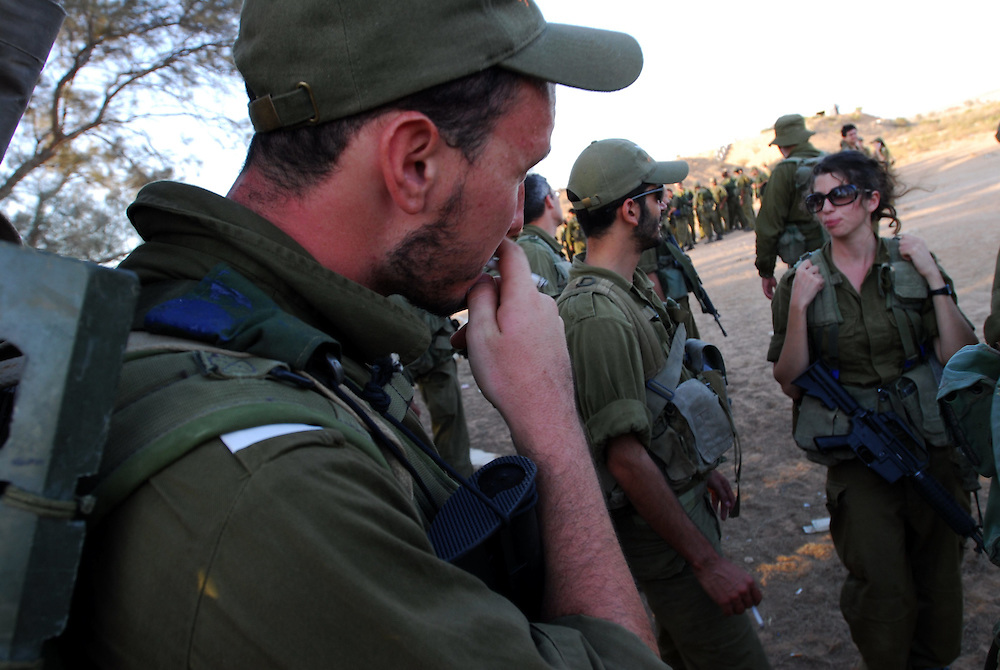 IDF woman and men reserve soldiers during training in the Negev Desert, South Israel on September 15, 2008. Following their active service, women, like men, are in theory required to serve up to one month annually in reserve duty. However, in practice only some women, mostly in combat roles, get called for active reserve duty, and only for a few years following their active service, with many exit points (e.g., pregnancy).