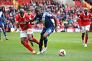 Birmingham City striker, Clayton Donaldson (9) battling for ball with Charlton Athletic defender, Rod Fanni (15) during the Sky Bet Championship match between Charlton Athletic and Birmingham City at The Valley, London, England on 2 April 2016. Photo by Matthew Redman.