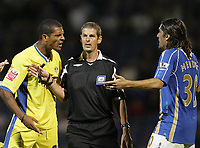 Photo: Lee Earle.<br /> Portsmouth v Leeds United. Carling Cup. 28/08/2007.Leeds Jermaine Beckford (L) squares up to Portsmouth's Pedro Mendes (R)