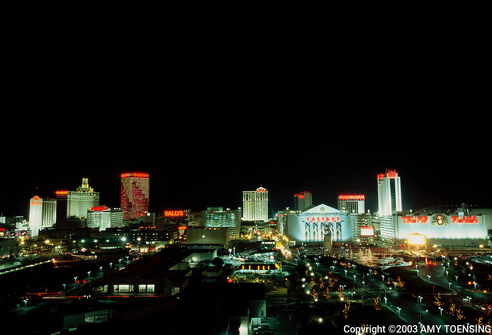 ATLANTIC CITY, NJ - NOVEMBER 01: Casinos illuminate the night skyline November 1, 2003 in Atlantic City, New Jersey. The Jersey Shore, a 127 mile stretch of coastline known for its variety of beaches, boardwalks, small towns, natural beauty and summer crowds, has been a popular summer destination for over a century. (Photo By Amy Toensing)