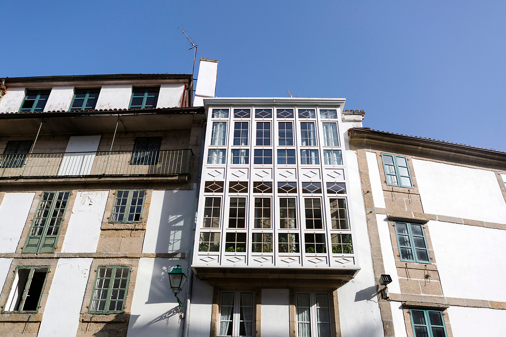 Old and modern architecture on a building exterior in Santiago de Compostela, Galicia, Spain.