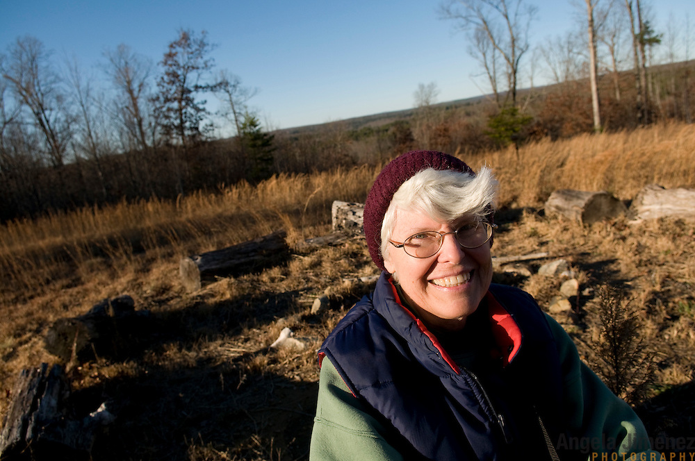 """Emily Greene, 62, helped build this space called The Knoll, which is used for spiritual gatherings and other rituals at Alapine, a """"womyn's land"""" or lesbian intentional community, in rural northeast Alabama. ..(*the exact town/location of the community cannot be revealed in the caption or article, per agreement with the subjects)..Photo by Angela Jimenez for The New York Times .photographer contact 917-586-0916"""