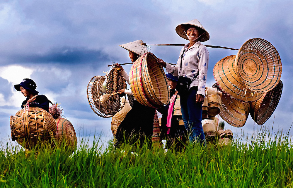 Women taking their baskets to the market on the Bolaven Plateau