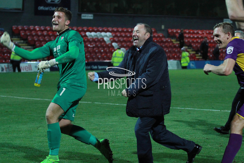 Dillon Phillips , Gary Johnson and Danny Wright celebrate the win during the Vanarama National League match between Grimsby Town FC and Cheltenham Town at Blundell Park, Grimsby, United Kingdom on 30 October 2015. Photo by Antony Thompson.