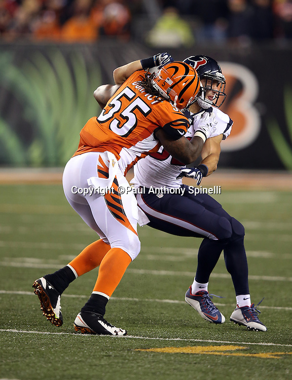 Cincinnati Bengals outside linebacker Vontaze Burfict (55) hits Houston Texans linebacker Brian Peters (52) during the 2015 week 10 regular season NFL football game against the Houston Texans on Monday, Nov. 16, 2015 in Cincinnati. The Texans won the game 10-6. (©Paul Anthony Spinelli)