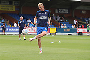 AFC Wimbledon midfielder Mitchell (Mitch) Pinnock (11) warming up in gold boots during the EFL Sky Bet League 1 match between AFC Wimbledon and Rotherham United at the Cherry Red Records Stadium, Kingston, England on 3 August 2019.